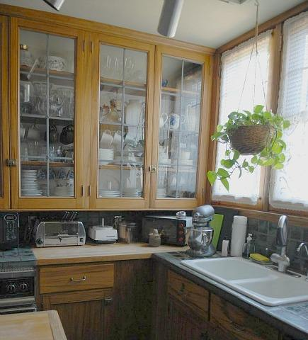low large row of uppers in gumwood cabinet kitchen with butcher block counters and drop in sink  before remodeling - Atticmag