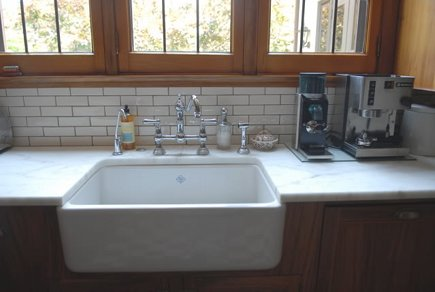 Rohl Shaws fireclay farmhouse sink with Perrin & Rowe chrome bridge faucet in a renovated vintage gumwood cabinet kitchen - Atticmag