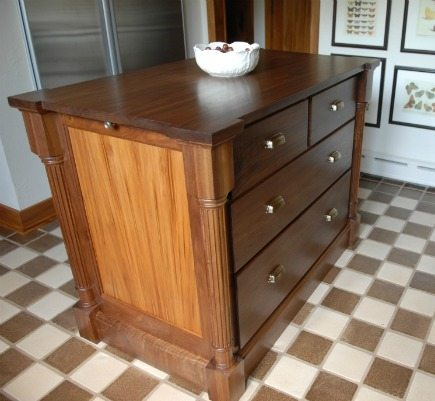 custom gumwood and walnut island in a vintage gumwood cabinet kitchen - Atticmag