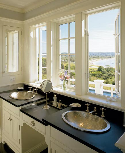 double hammered metal oval drop in sinks in a soapstone vanity