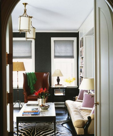 black room with white trim by Nate Berkus