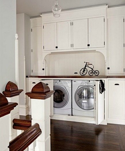 washer dryer cabinet in upstairs hallway by Danielle Oakely Interiors via Atticmag