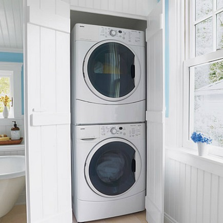 hidden laundry spaces - washer dryer laundry closet in bathroom from This Old House via Atticmag