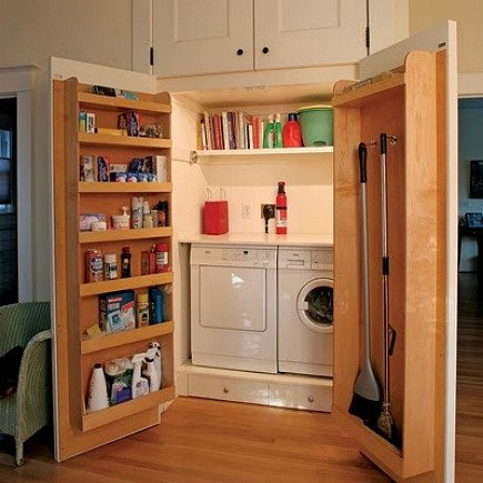 hidden laundry spaces - laundry room closet with interior door storage shelves from Junk Garden Girl via Atticmag