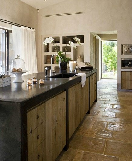 rustic Spanish kitchen with black concrete counter island - style-files.com via Atticmag