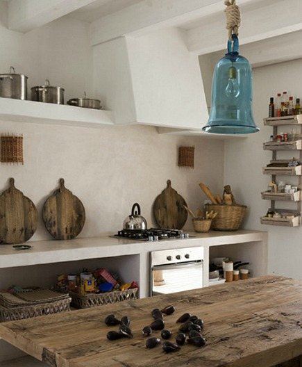 rustic Spanish kitchen with concrete counters and shelving - Jordi Canosa via Atticmag