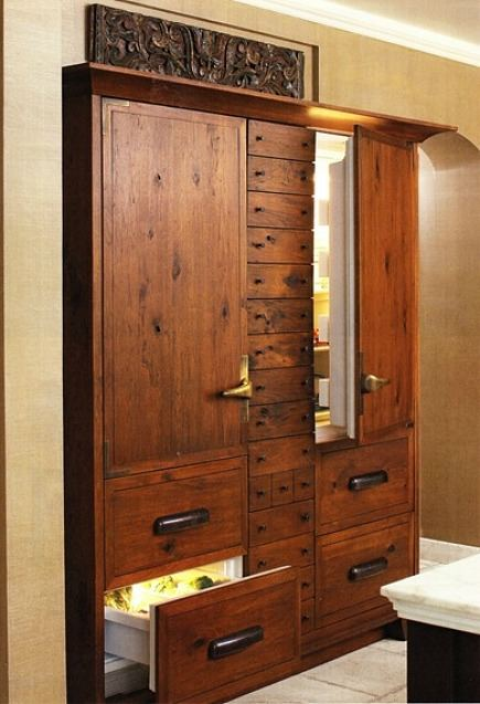 furniture style kitchen refrigeration armoire with storage drawers between appliances