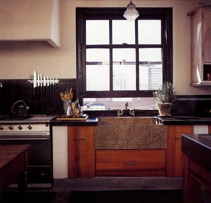 Pratt & Lambert Obsidian black window in industrial look kitchen with reclaimed wood, marble farm sink and concrete floors - Metropolitan Home via Atticmag