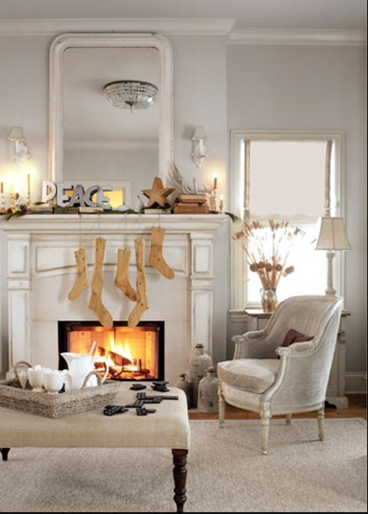 Christmas mantel - vintage wooden sock stretchers are used in lieu of Christmas stockings - Country Living via Atticmag