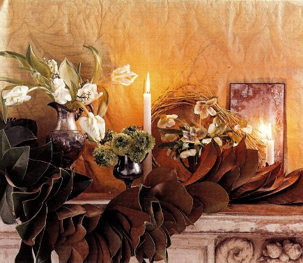 magnolia leaf garland and white tulips on a mantel