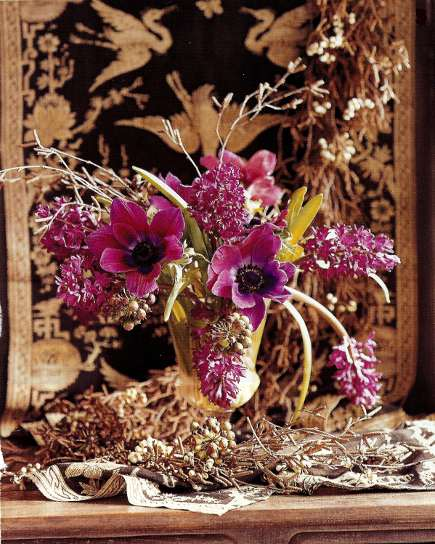 anenomes and fuchsai hyacinth in a glass vase