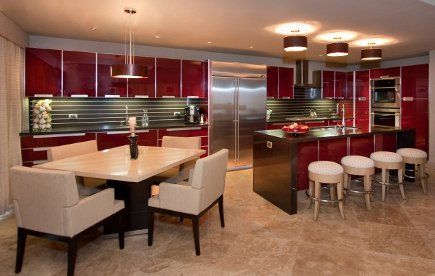 open kitchen with modern red high gloss lacquer cabinets