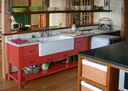 red sink cabinet in the style of an English island with pot shelf below