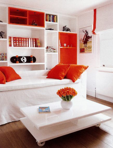 white and orange color-block bedroom with orange accents and accessories