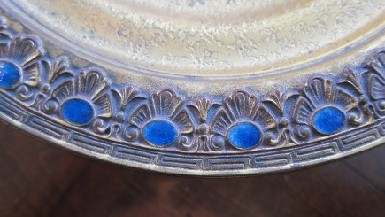 close up of the favrile glass inlay in the rim of the bronze dore Tiffany centerpiece bowl