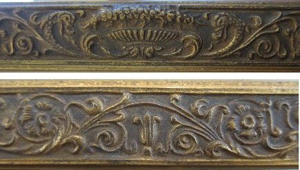 top and bottom motifs on on the frame of a bronze dore Tiffany Studios picture frame