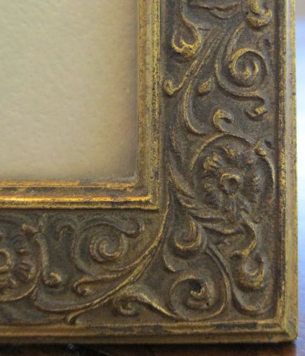 corner detail of a Tiffany Studios bronze dore picture frame