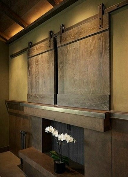 sliding interior barn doors cover a flat screen tv