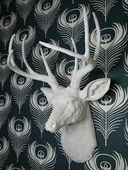 faux deer decor - white painted faux resin deer head trophy - via Atticmag
