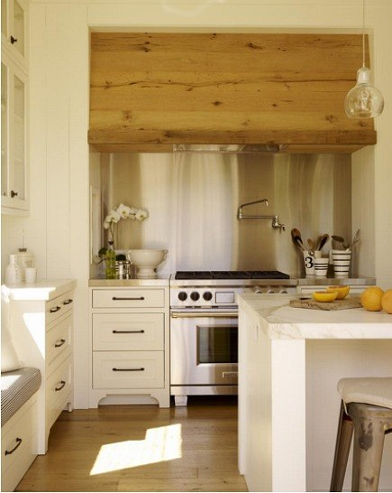 modern white farmhouse kitchen with oak wood range hood by Ken Linsteadt Architects