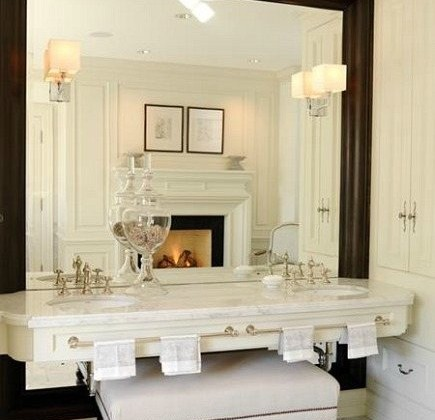 oversized bathroom mirror - floating vanity is mounted over an oversized wood framed mirror by Julie Charbonneau - House and Home via Atticmag