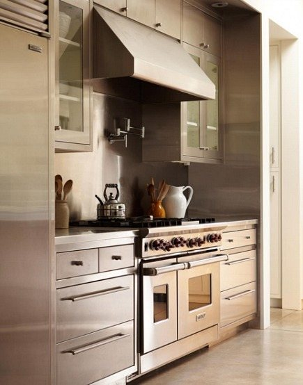stainless steel range niche -all stainless cabinets with a Wolf range in a kitchen by Ken Linsteadt via Atticmag