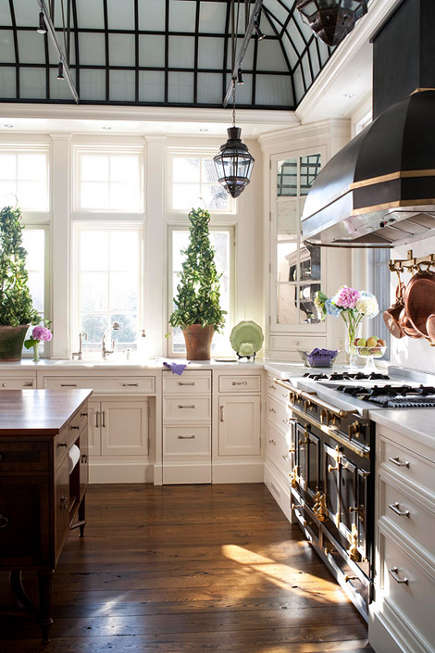 kitchen with French style glass ceiling and antique furniture style island