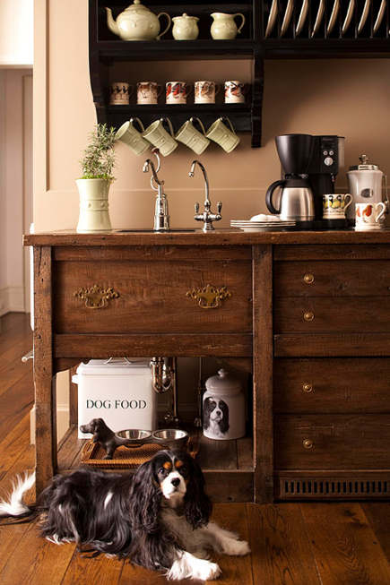 breakfast room bar and hutch also includes a pet-feeding station