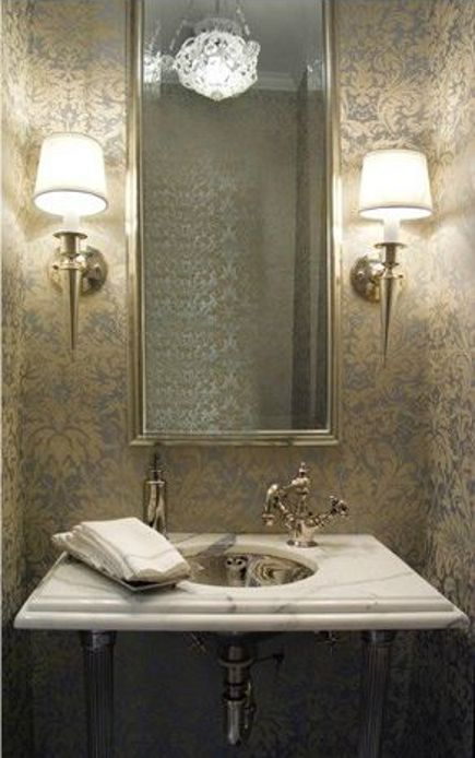 silver theme powder room with marble top console sink by Michael Richman