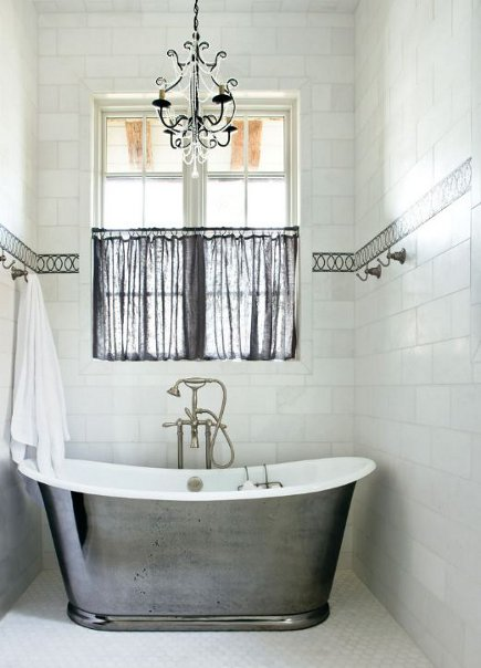 silver tub in a white-tiled niche with gray accents