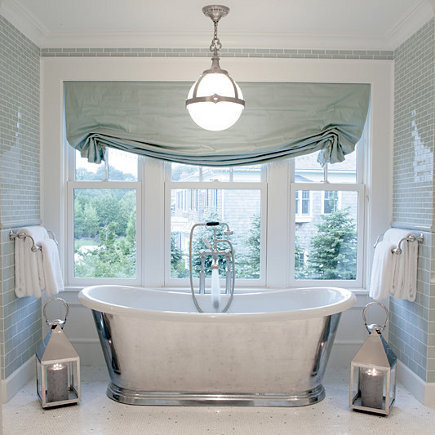 silver tub in a glass-tile bathroom by Mabley Handler design