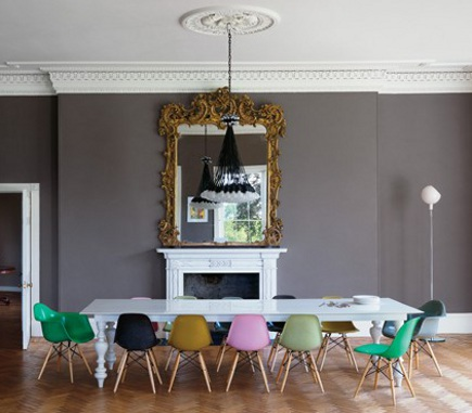 dining room with mixed colors of Eames down-leg molded chairs