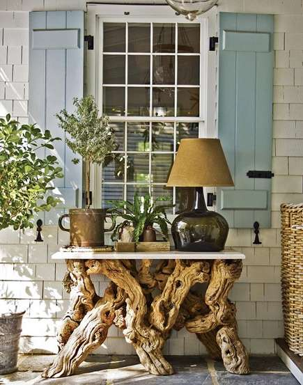 gnarled wood table and lamp front porch by Steven Gambrel