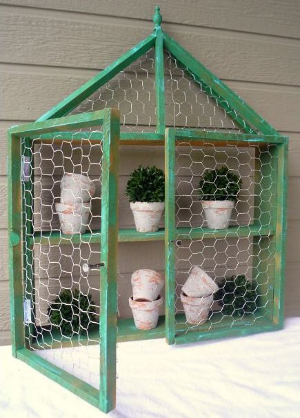 chicken wire display cabinet with peaked roof and finial