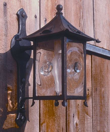 custom made - barn lantern with hand blown bulls eye glass by Rising Sun Forge via Atticmag
