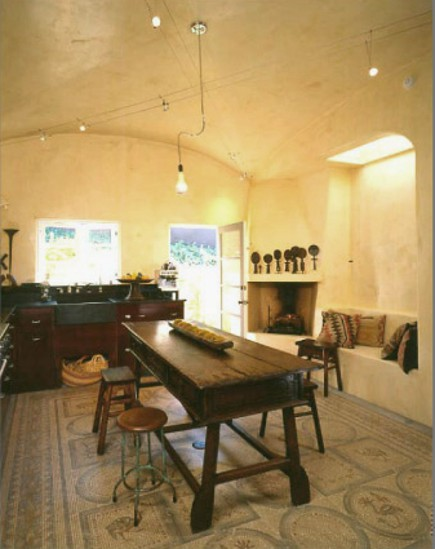 table, ceiling and floor of spanish style kitchen with mosaic floor