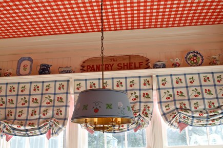 red theme Diamond Baratta kitchen with blue tole pendant light
