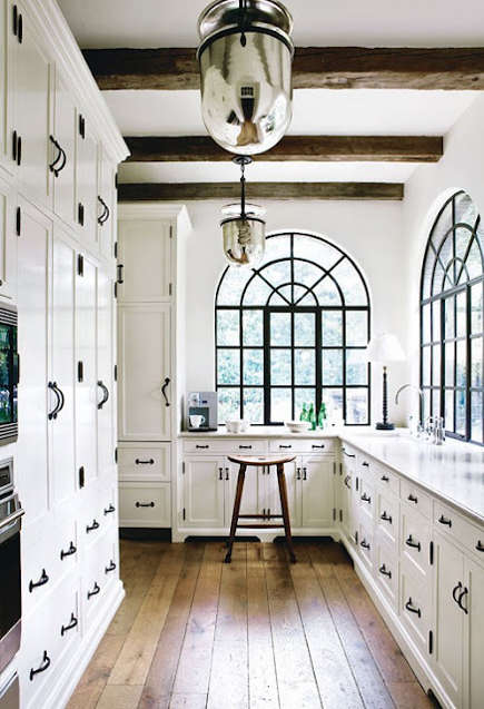 white kitchen with black hardware matching steel-palladian windows
