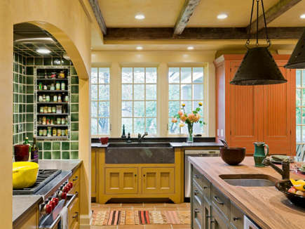 yellow farmhouse kitchen with pine green tiled range niche
