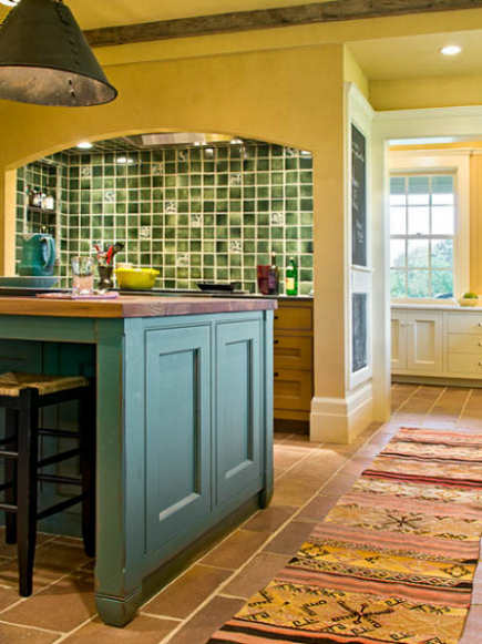 yellow farmhouse kitchen with green-tiled range niche