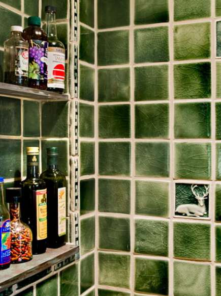 green tile range niche in yellow farmhouse kitchen