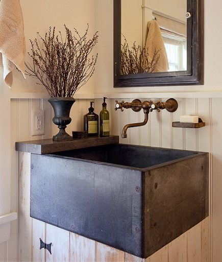 dark square basin sink used on a bead board bathroom vanity