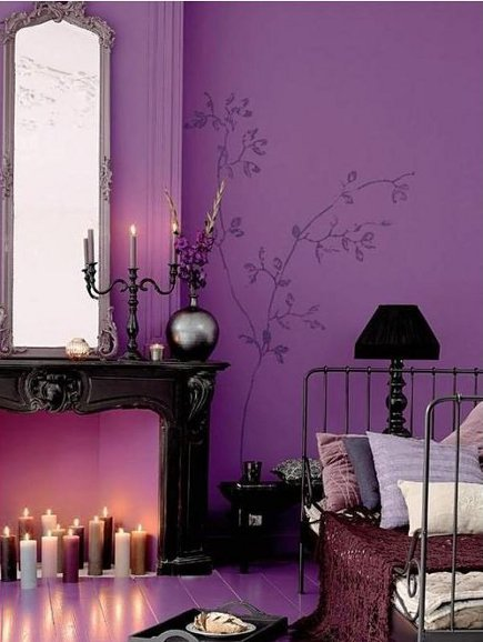 magenta walls iwith stenciled trees in a purple bedroom