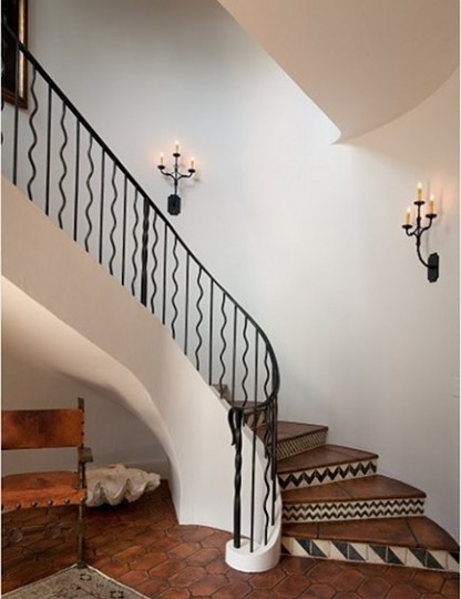 foyer with decorative wrought iron railing staircase from Thomas Thaddeus Truett Architect