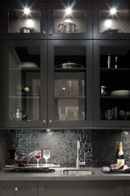 kitchen with gray and black kitchen cabinets and black irridescent mosaic tile