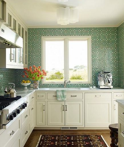 shamrock green and white patterned tile in a white kitchen