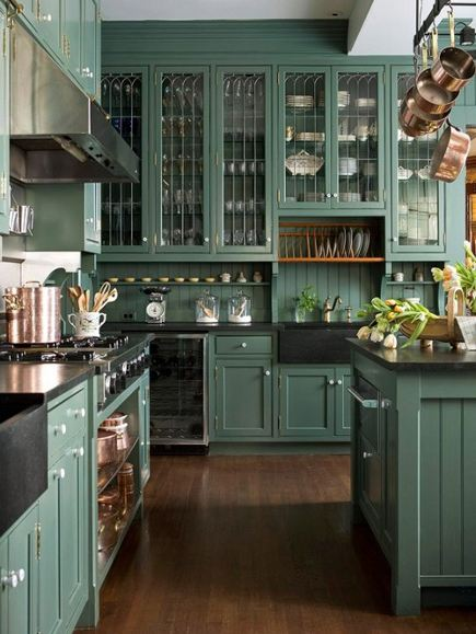 kitchen with pine green cabinets and black soapstone farm sinks