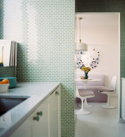kitchen with walls tiled in mint-green mini subway mosaic