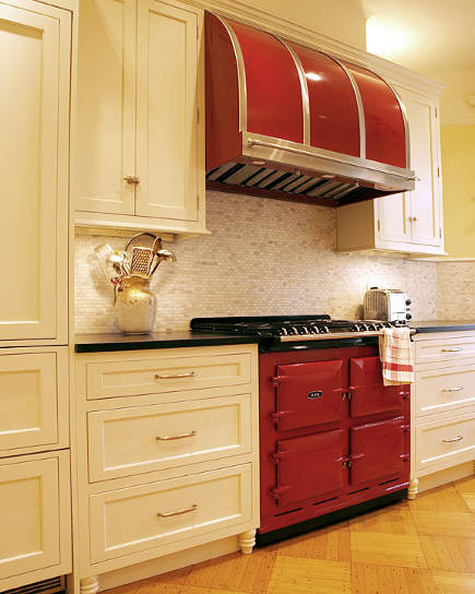 Claret red Aga 6-4 range with matching Modernaire hood in a white kitchen
