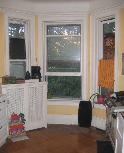 original kitchen with bay window and tall radiator
